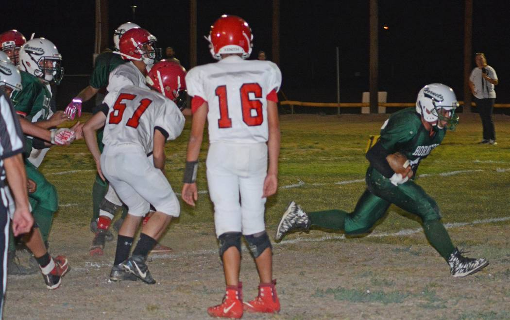 Richard Stephens/Pahrump Valley Times  Jose Moreno scores a TD against Tonopah on Friday night. Beatty beat the Muckers 66-18.
