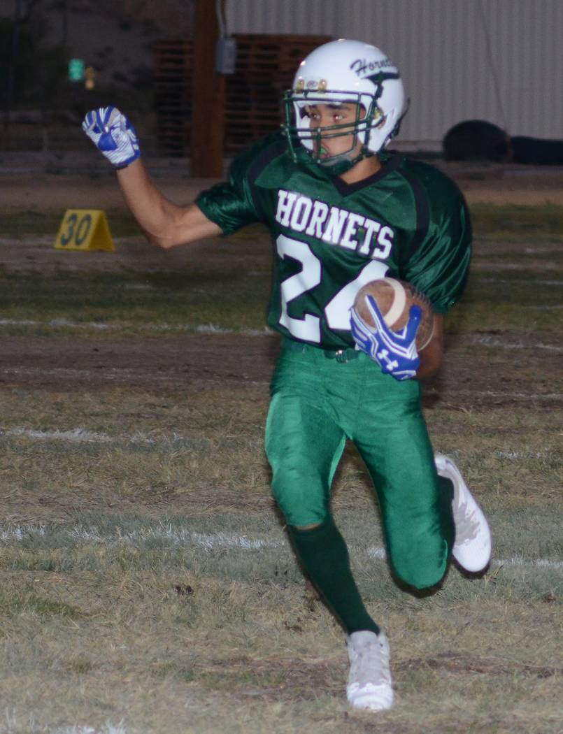 Richard Stephens/Pahrump Valley Times  Yadir Rodriguez runs the ball down the field for Beatty. He had a big night with 110 yards rushing.