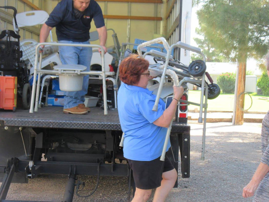 Selwyn Harris/Pahrump Valley Times  LaaRee Drawantz, Director of Assisted Technology for Easterseals Nevada, unloads a walker and numerous other supplies at the Pahrump Senior Center last Friday.  ...