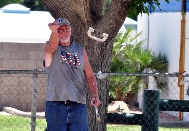 Horace Langford Jr / Pahrump Valley Times   Don Brown puts a flip on a horseshoe in Petrack Park. The horeshoe pits at Petrack Park are by the pool and are a fun place to learn the game of horsesh ...