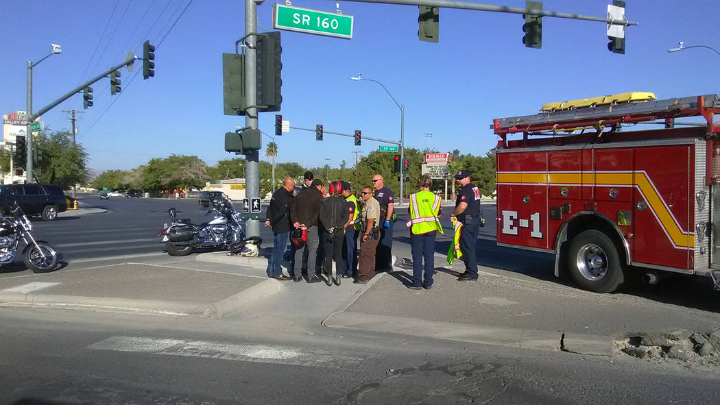 Selwyn Harris/Pahrump Valley Times  Selwyn Harris/Pahrump Valley Times  Pahrump EMS crews and Nye County sheriff's deputies speak to a group of motorcyclists after a crash at Highway 160 and Bas ...