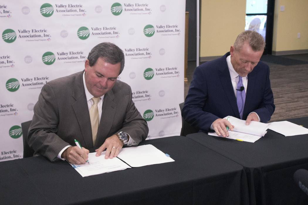 Jeffrey Meehan/Pahrump Valley Times Calvin Crowder, Gridliance president and CEO (left) and Thomas Husted, CEO of Valley Electric Association, sign the final documents for the completion of the sa ...