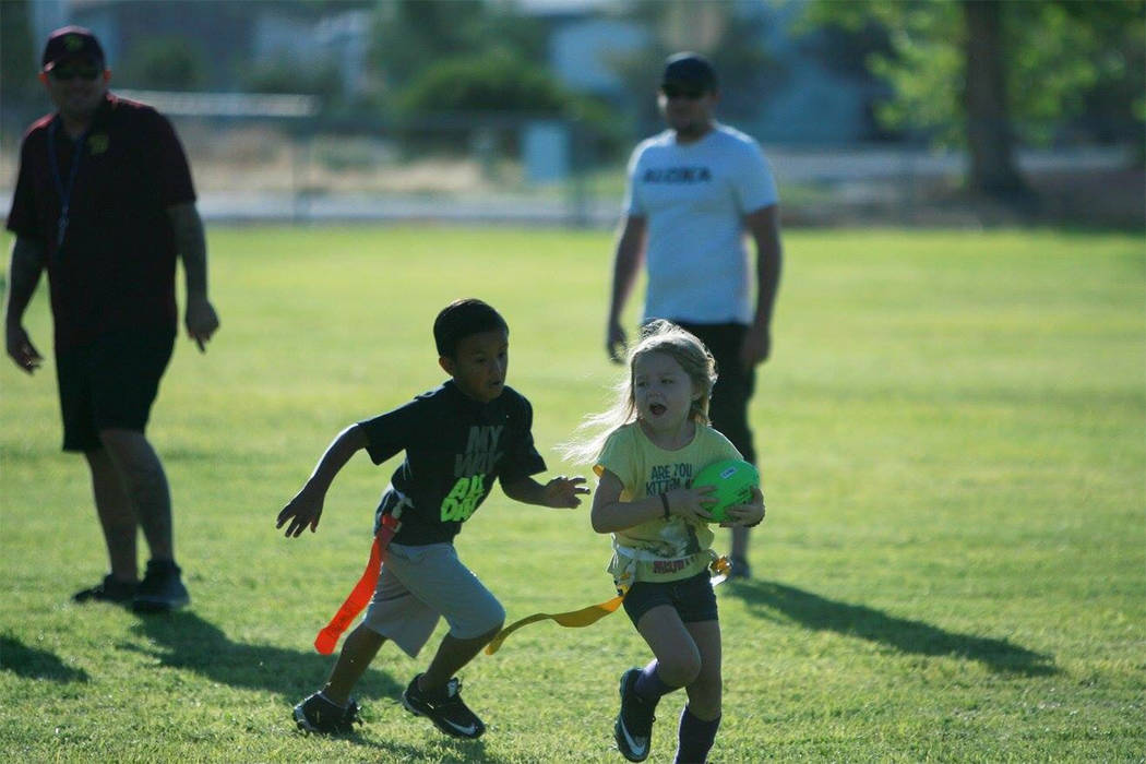 Desiree Castaneda/ Special to the Pahrump Valley Times  Marshawn Lynch, watch out girl! Farra Hudgens, who plays for the Trojan Spear, runs for some tough yards at the flag football scrimmage at S ...