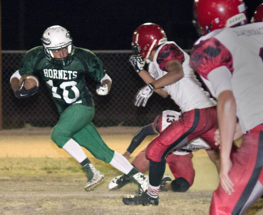 Richard Stephens/Pahrump Valley Times Sophomore Hornets running back Fabian Perez takes the ball down the field against Beaver Dam.