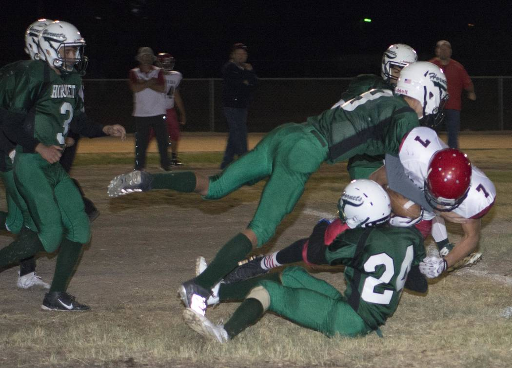 Richard Stephens/Pahrump Valley Times Jacob Henry and Yadir Rodriguez make a tackle in the Beaver Dam game last Friday night.
