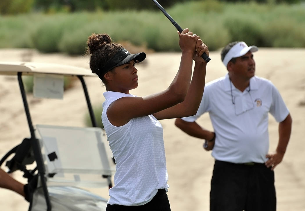 Horace Langford Jr./Pahrump Valley Times Sophomore Ashliegh Murphy for Pahrump tees off the ball at a recent Mountain Falls match. The team will depend on golfers like Murphy to score well at the  ...