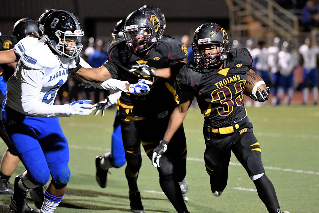 Peter Davis/Special to the Pahrump Valley Times  Junior running back Casey Flennory runs the ball against the Jaguars. Last week the Trojans were able to run the ball against Desert Pines, the def ...