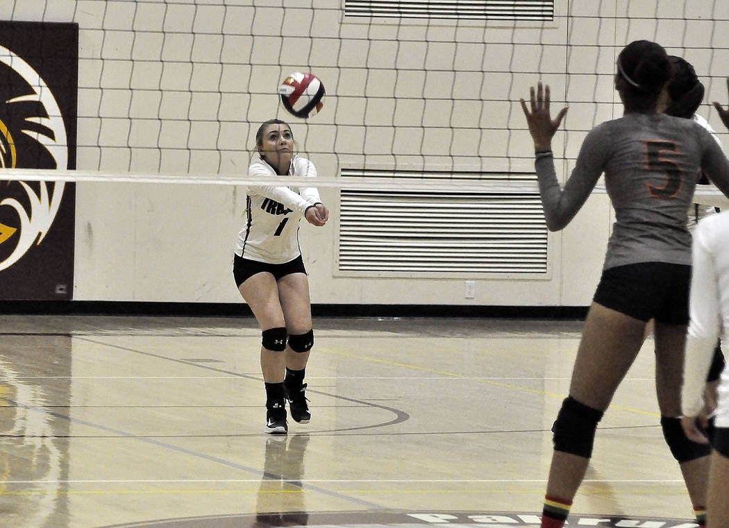 Horace Langford Jr./Pahrump Valley Times  Junior player, Elaina Dattilio, bumps the ball in the Mojave game on Tuesday night. The Trojans had some great digs and didn't falter on defense.