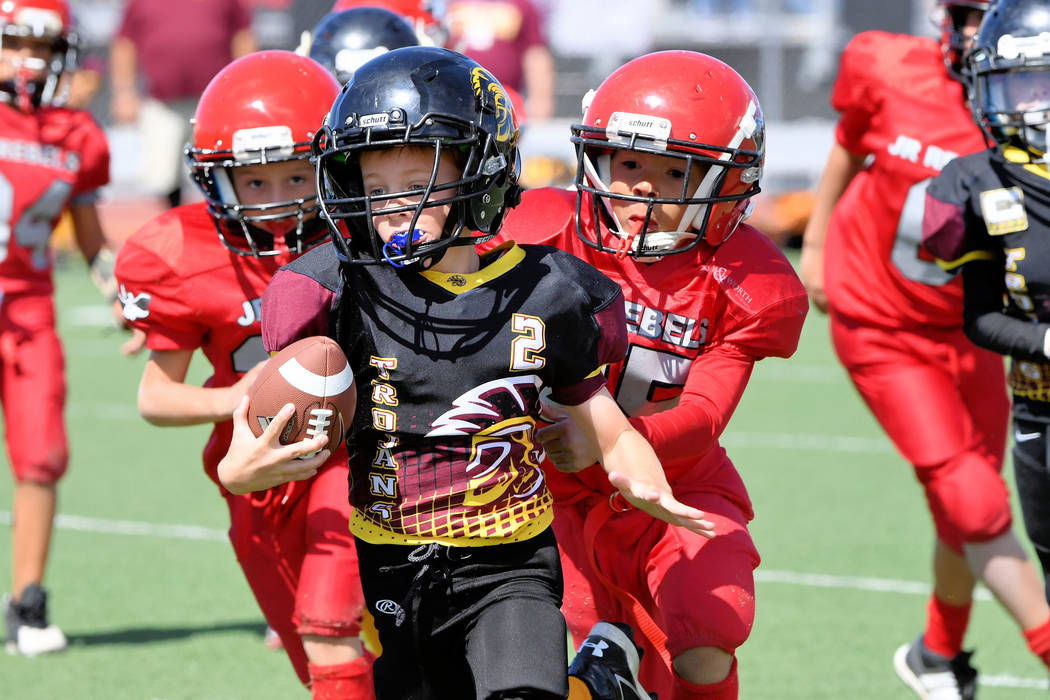 Peter Davis/Special to the Pahrump Valley Times  Paul Walker, 9U Trojans, runs with the ball toward the end zone with the whole team after him.