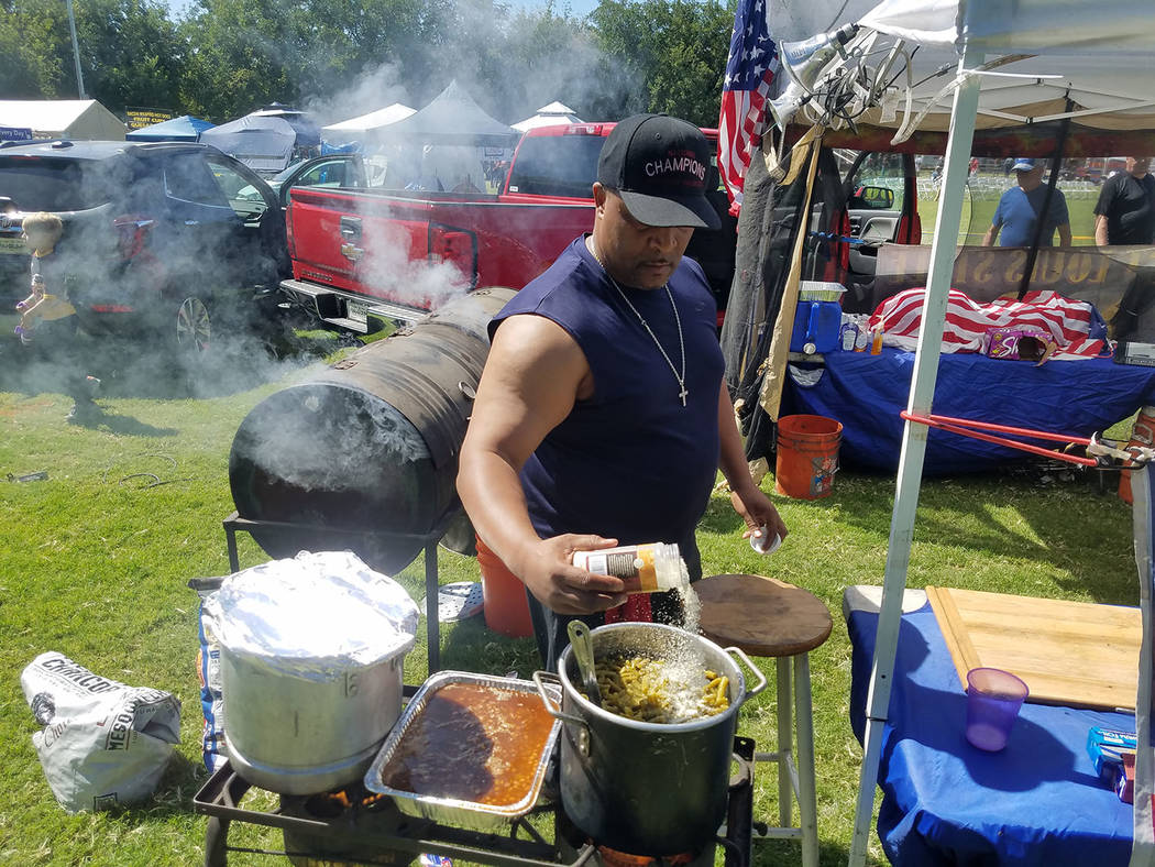 David Jacobs/Pahrump Valley Times Fred Moss, CEO of Moss Grills of San Diego cooks up some food at his St. Louis-Style BBQ at the annual Pahrump Fall Festival in Petrack Park on Sept. 23. Moss is  ...