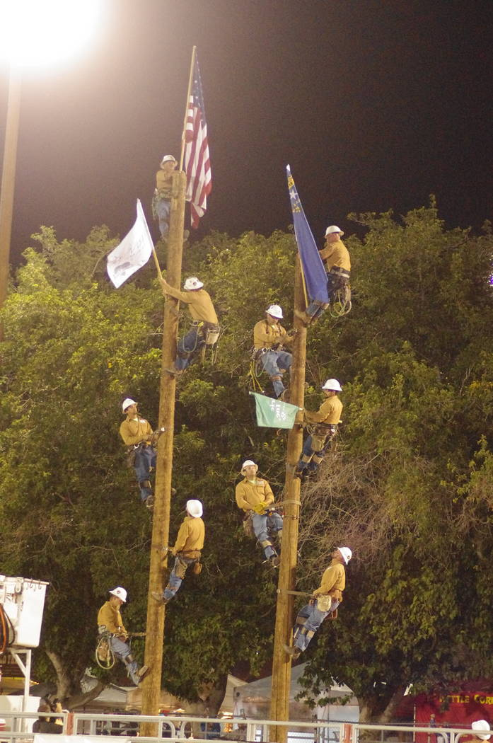 Ryan Muccio/Special to the Pahrump Valley Times Valley Electric Association linemen in action as the Pahrump Fall Festival rodeo was set to kick off Saturday. The linemen were part of what Muccio  ...