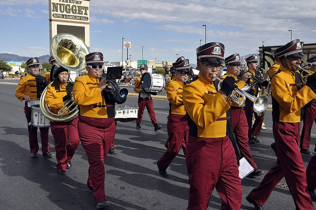 Horace Langford Jr./Pahrump Valley Times - Members of the Pahrump Valley High School marching band make their way down the parade route, while belting out musical favorites to the delight of parad ...