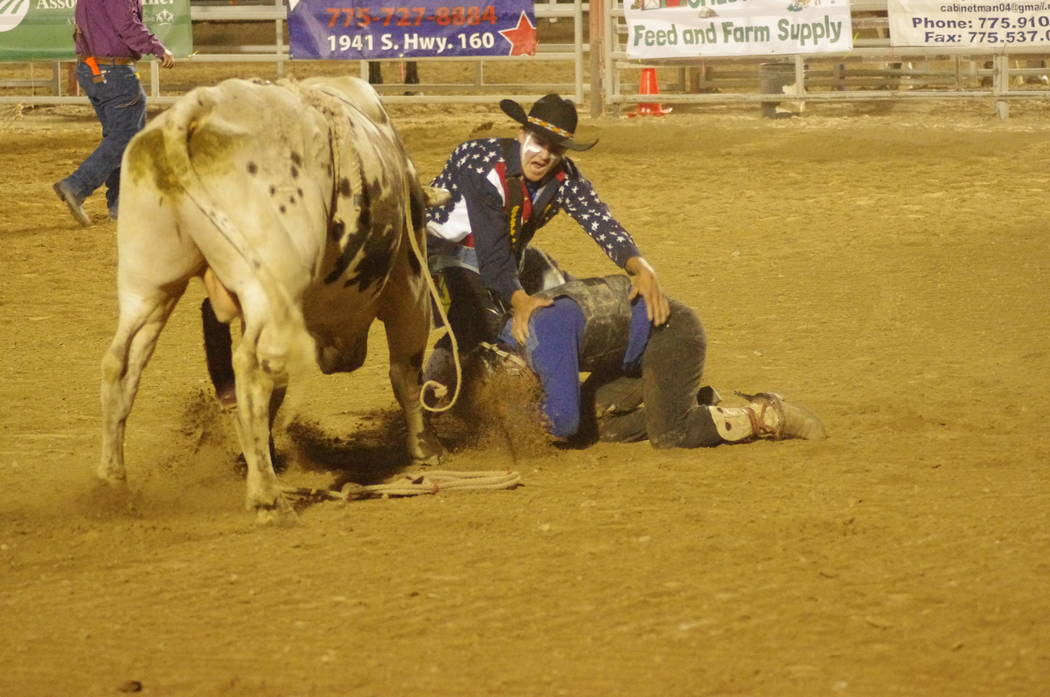 Vern Hee/Pahrump Valley Times A bullrider gets a dirt snack after falling off the bull during the Rocky Mountain Rodeo last Friday.