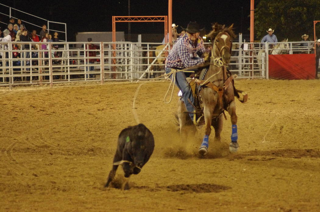 Vern Hee/Pahrump Valley Times Got em! The crowd didn't have long to wait for calf to be roped. This cowboy was good with the rope and was first up out of the chute.