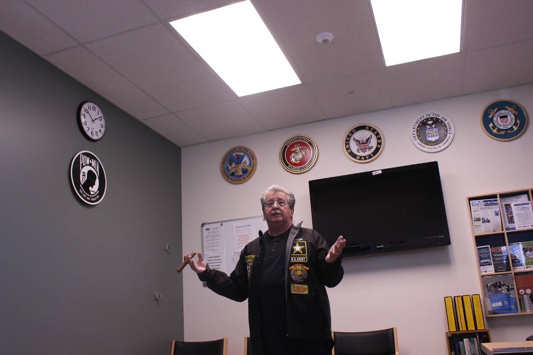 Jeffrey Meehan/Pahrump Valley Times U.S. Army veteran Bernie Cusimano speaks at the Pahrump VA Community Based Outpatient Clinic about the instillation of several plaques bearing the seal of the f ...