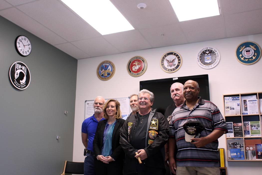 Jeffrey Meehan/Pahrump Valley Times Representatives from the town of Pahrump, Nye County Commission and veterans of the U.S. armed forces stand in front of the recently installed military plaques  ...