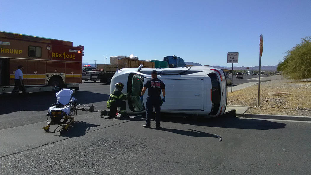 Selwyn Harris/Pahrump Valley Times A Pahrump woman was transported to Desert View Hospital after a high-impact collision along Highway 160 at the SuperPawn business entrance. Fire crews were force ...