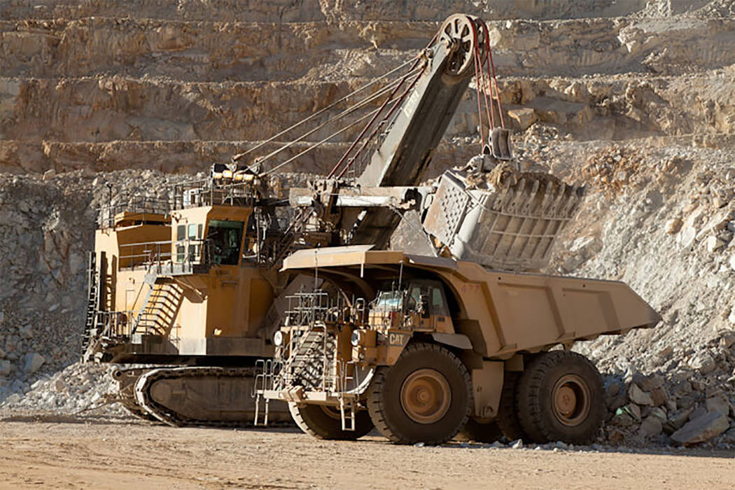 Special to the Pahrump Valley Times Heavy machinery at work at Round Mountain gold mine in an undated photo provided by the mien's owner, Kinross Gold. Phase W is expected to extend mining by five ...