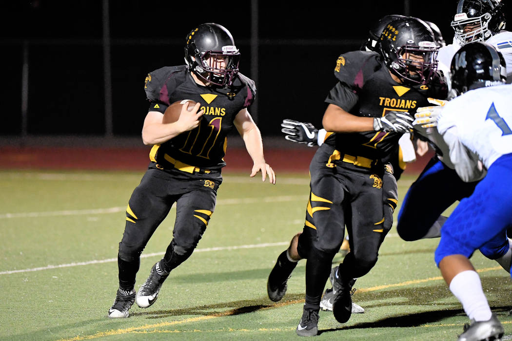 Peter Davis/Special to the Pahrump Valley Times Senior Trojans running back, David Roundy, rounds the corner last Friday against Desert Pines.