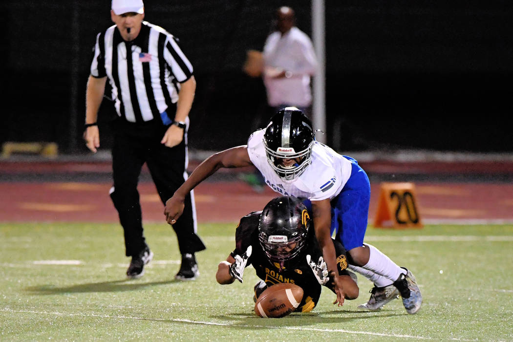 Peter Davis/Special to the Pahrump Valley Times DeAngelo Brown recovers a fumble during the Desert Pines game. The Jaguars made numerous mistakes and had numerous penalties, but the Trojans failed ...