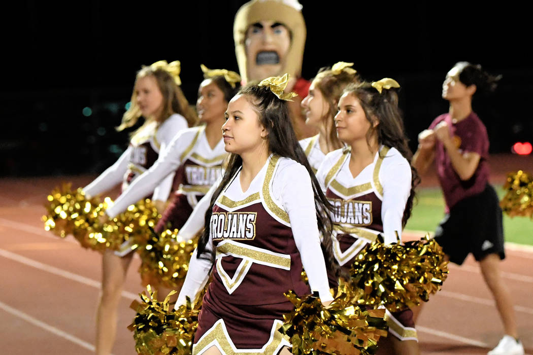 Peter Davis/Special to the Pahrump Valley Times  Pahrump Valley's cheer squad cheers on the Trojans football team during last week's home game against Desert Pines.