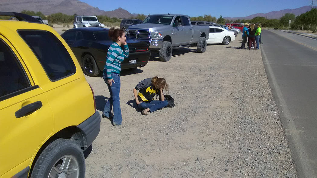 Selwyn Harris/Pahrump Valley Times  The mother of a Manse Elementary School students anguishes as sheriff's deputies search the campus for wanted felon Duane Johnson. Mother and child were event ...