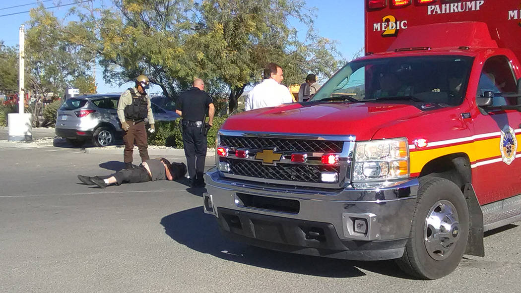 Selwyn Harris/Pahrump Valley Times  A local man was transported to Desert View Hospital just before 9 a.m., on Wednesday, Sept. 27, after crashing his motorcycle in the parking lot of Green Valley ...