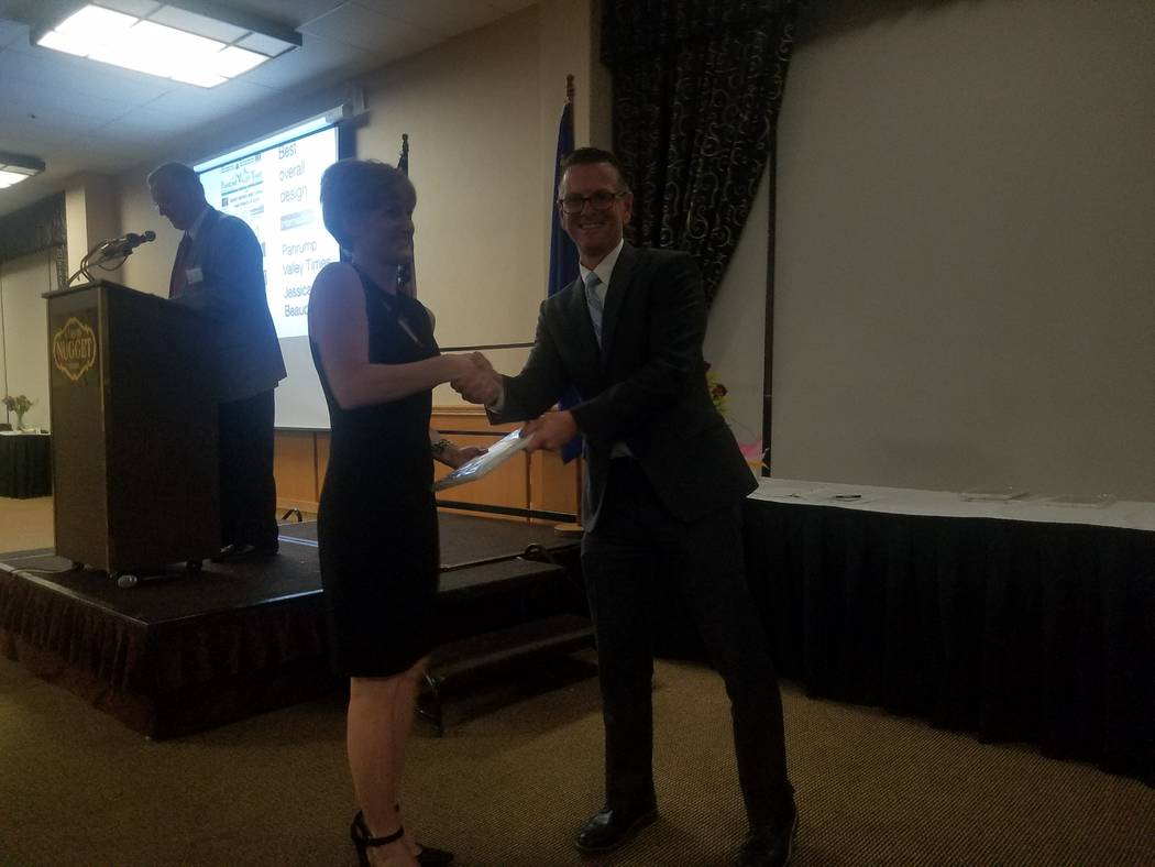 Special to the Pahrump Valley TImes  Jessica Beaudoin, page designer for the Pahrump Valley Times, Tonopah Times-Bonanza and Las Vegas Review-Journal, is honored with a first place award by Ric An ...