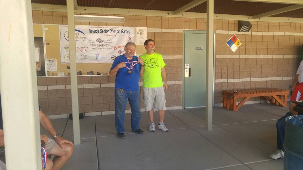 Special to the Pahrump Valley Times  Bill Morris displays his two gold medals from this year's shooting competition on Sept. 13 at the Nevada Senior Games in Las Vegas. The games started on Sept ...
