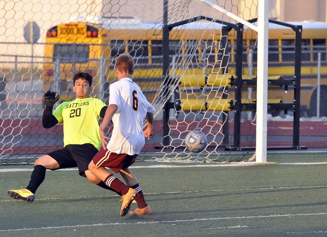 Freshman Vincent DiBlasi puts the ball into the net for a goal. The Trojans came from behind to score three goals in the second half to tie the game.