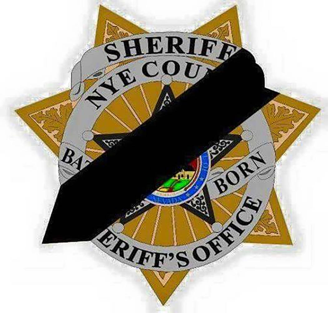 Special to the Pahrump Valley Times  Nye County Sheriff Sharon Wehrly issued a decree this week for all Nye County deputies to shroud their badges with black bands in honor of fallen LVMPD Officer ...