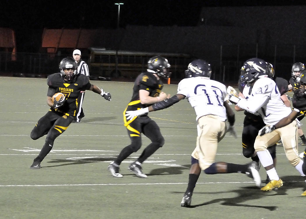 Horace Langford Jr./Pahrump Valley Times DeAngelo Brown is seen with a clear field ahead of him. He also had a big night with 75 yards rushing against Cheyenne.