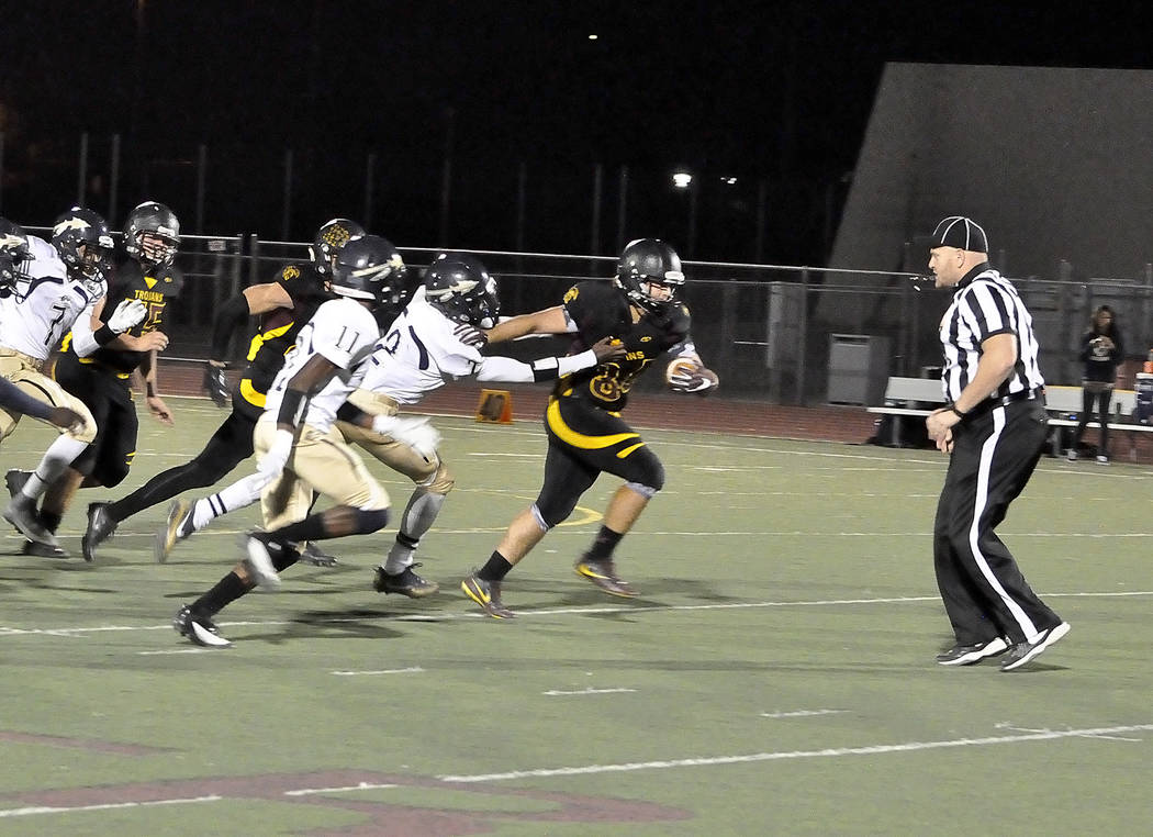 Horace Langford Jr./Pahrump Valley Times Nico Velazquez breaks a tackle for big yardage during the Cheyenne game last Friday. Velazquez led the Trojans in rushing with 164 yards as the Trojans gar ...