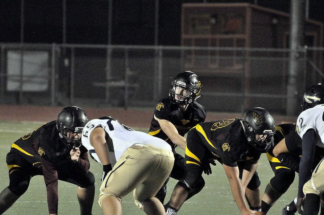 Senior quarterback Dylan Coffman, seen under center, had only 34 yards rushing but he fought hard for every yard and scored two touchdowns on quarterback keepers, running up the middle.