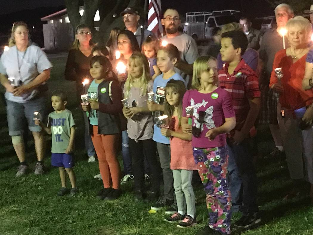 Jeffrey Meehan/Pahrump Valley Times Several Pahrump residents, including children, turned out for a candlelight vigil on Oct. 6, 2017 at Ian Deutch Park to remember the hundreds injured and the lo ...