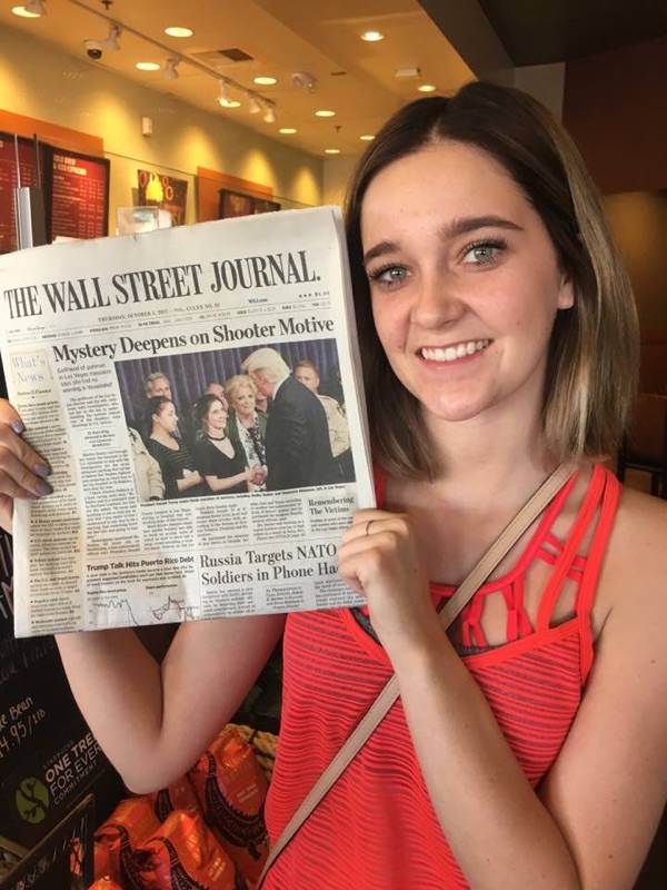 Special to the Pahrump Valley Times Happy to be alive, survivor of the Route 91 Harvest Festival shooting, Shelby Stalker, holds up a Wall Street Journal that shows her shaking hands with Presiden ...
