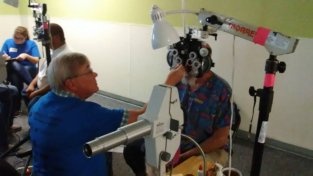 Selwyn Harris/Pahrump Valley Times  A Pahrump man undergoes an eye exam at the Remote Area Medical event on Saturday. Patients did not have to pay for their respective medical services during the  ...