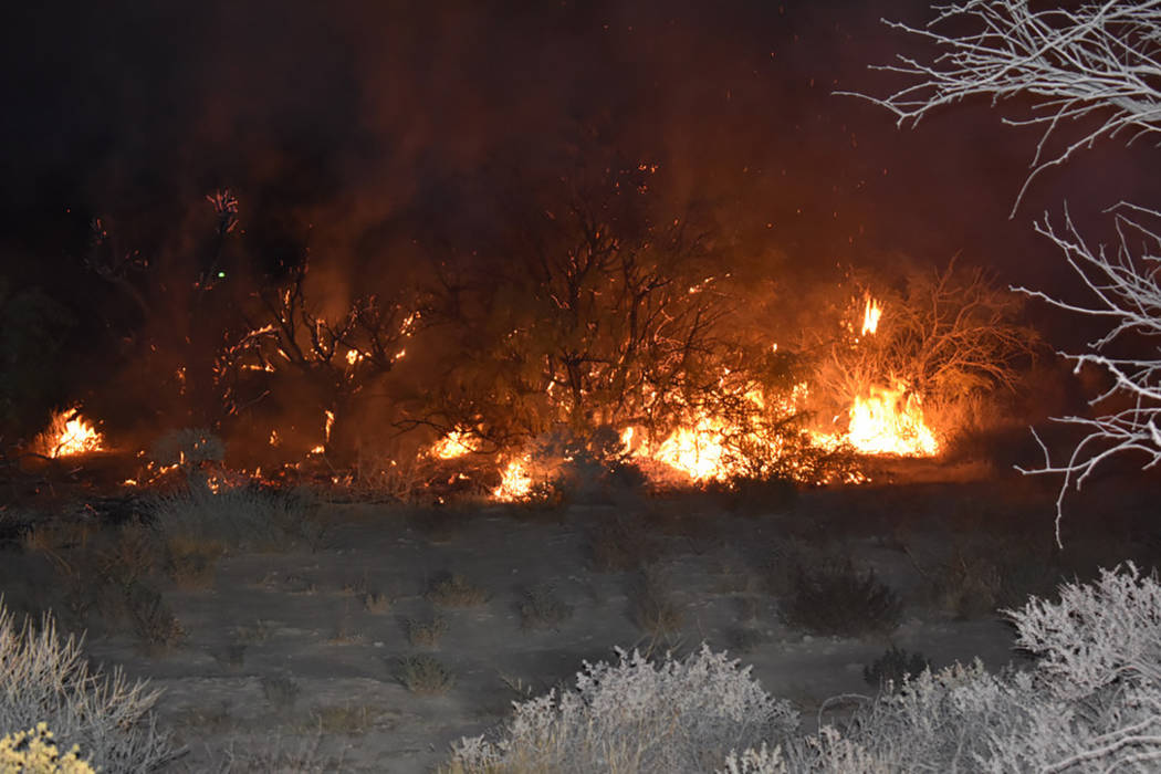 Special to the Pahrump Valley Times  Fireworks is believed to be the cause of a 10 p.m. brush fire along the 600 block of Marie Street on Friday Sept. 29. Pahrump crews extinguished the fire witho ...