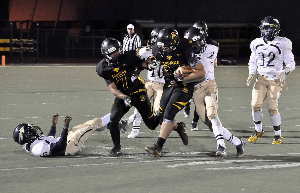 Horace Langford Jr./Pahrump Valley Times  Junior running back Nico Velazquez breaks a tackle for big yards against Cheyenne last week. The Trojans expect to do the same against Sunrise Mountain to ...