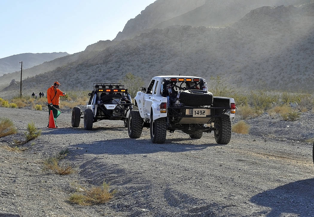 Horace Langford Jr./Pahrump Valley Times  Two SNORE racers line up at the start line. The racers were staggered and left the start line every two minutes. The SNORE 250 started in the same place t ...