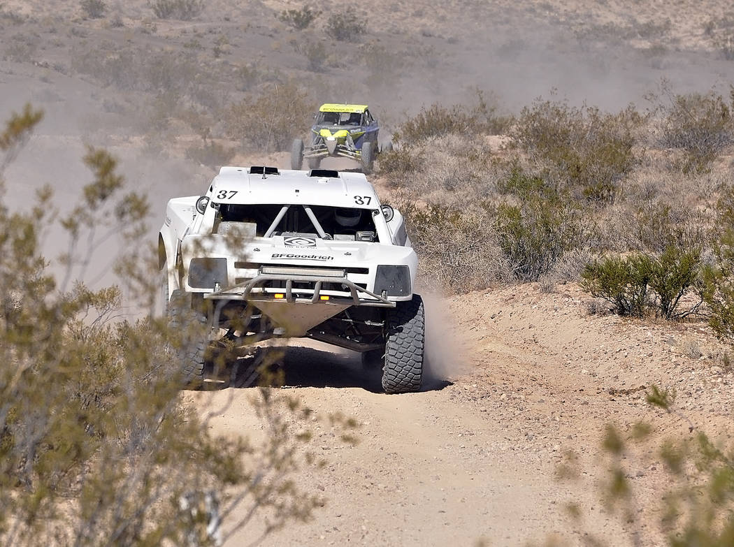 Horace Langford Jr./Pahrump Valley Times  SNORE racers go through a small valley near the old Tonopah-Tidewater railroad beds across from the old Beatty dump. It was a perfect place to watch a rac ...