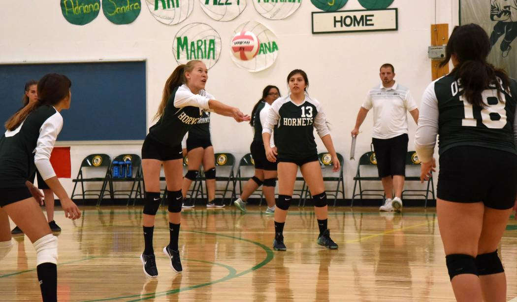 Richard Stephens/Pahrump Valley Times  Andrea Leon digs out a Sandy Valley ball. The Hornets beat Sandy Valley three sets to zero.
