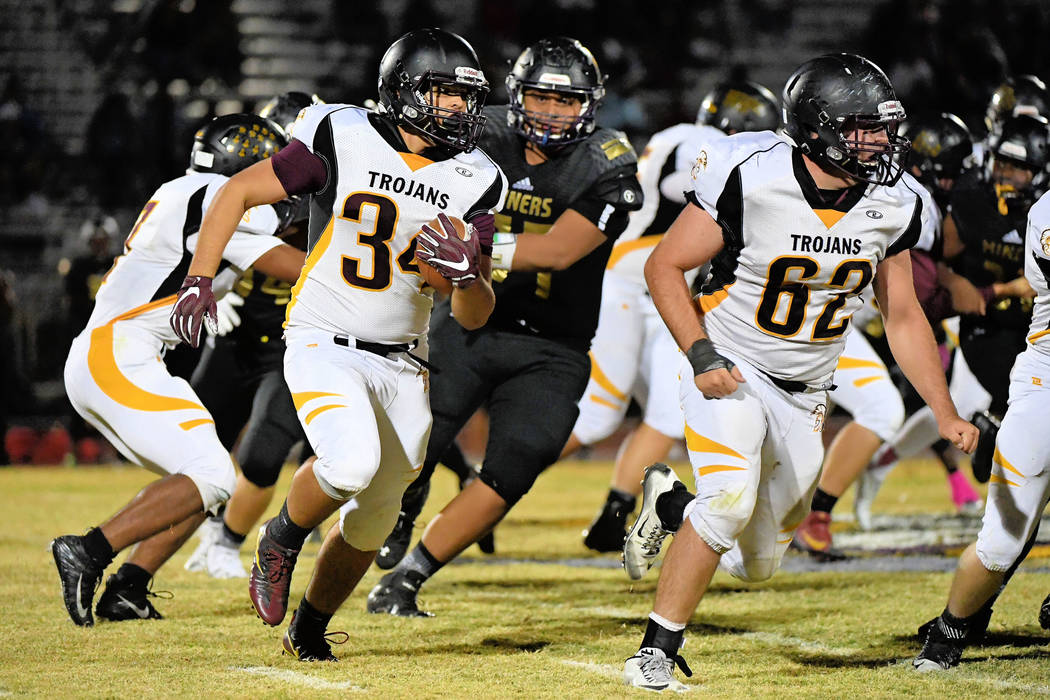 Peter Davis/Special to the Pahrump Valley Times Junior Trojans running back Nico Velazquez is run down by the Sunrise Mountain defense. Velazquez had 35 yards that night.