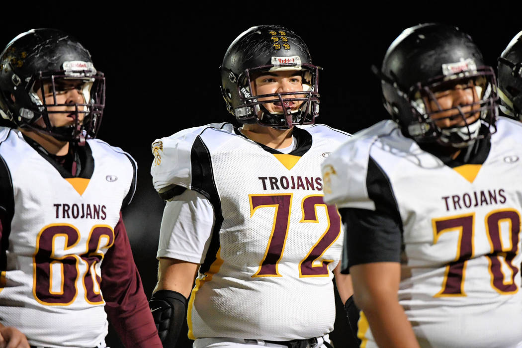 Peter Davis/Special to the Pahrump Valley Times The Trojans front line takes a breather during the Sunrise Mountain game. The team had their hands full as they were held scoreless for three quarters.