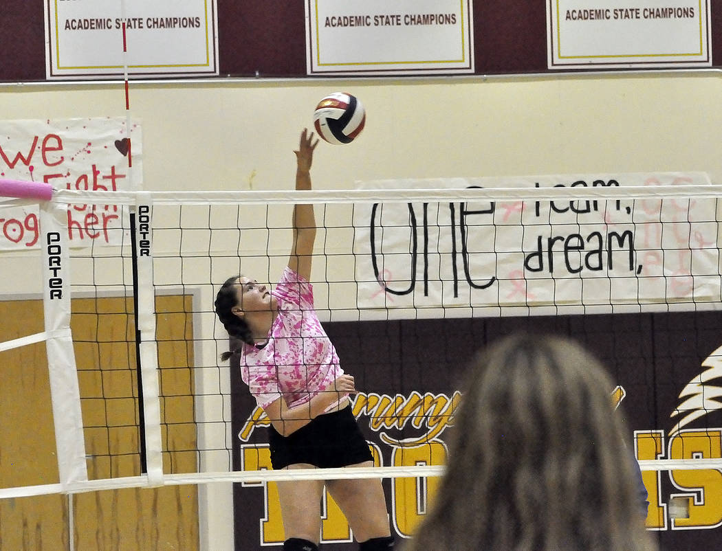 Horace Langford Jr./Pahrump Valley Times  Freshman Kathryn Daffer goes up high to spike the ball against the Jaguars on Monday night. The Trojans won three sets to zero.