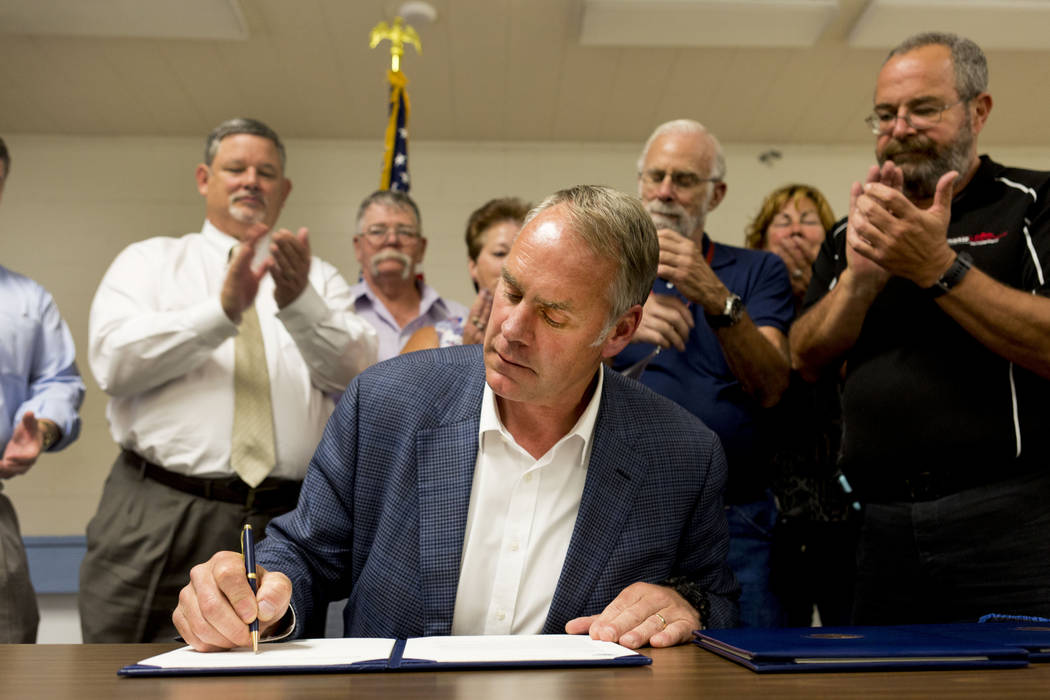 Elizabeth Brumley/Las Vegas Review-Journal  U.S. Secretary of the Interior Ryan Zinke (seated) at the Bob Ruud Community Center in Pahrump, on Monday, June 26, 2017. Zinke is a break from recent I ...
