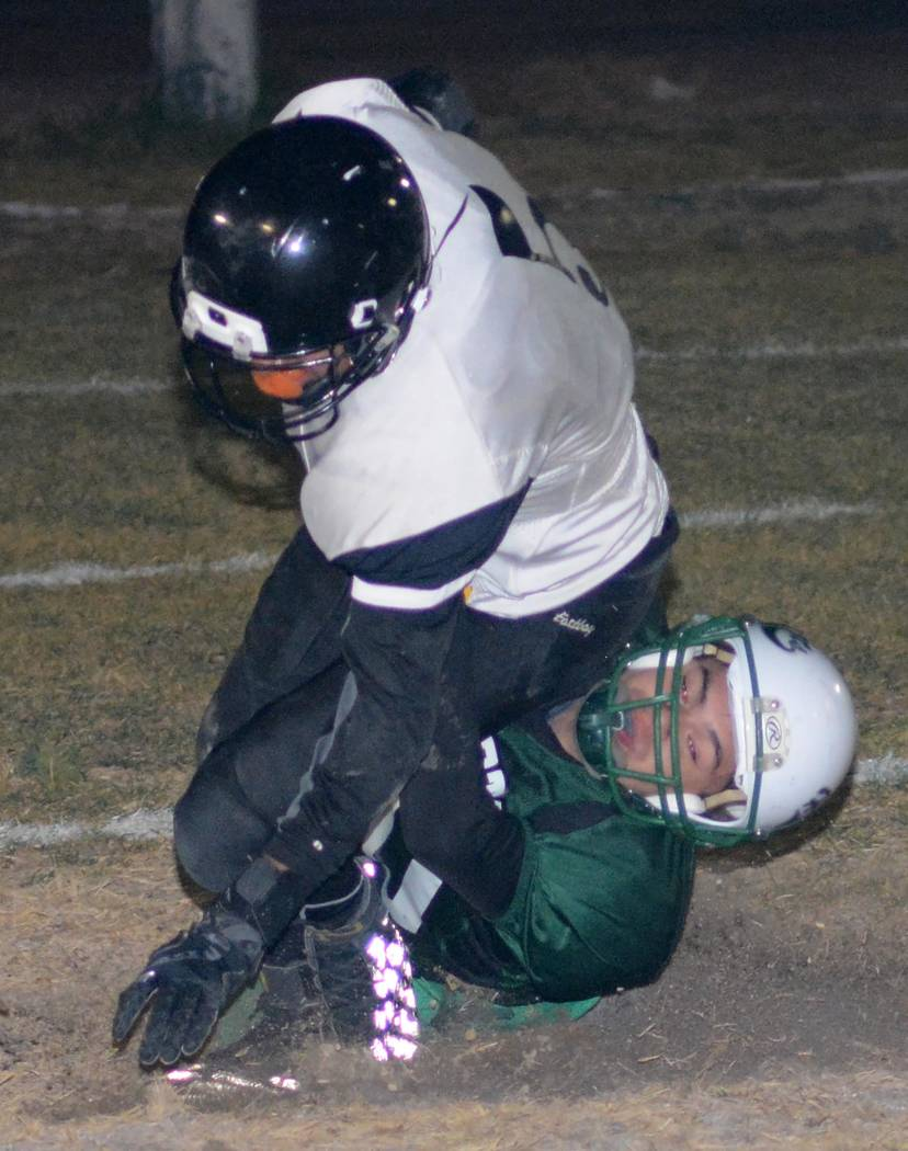 Richard Stephens/ Special to the Pahrump Valley Times  Alan Sandoval is seen making a tackle against Round Mountain. Sandoval also had one of two TD receptions that night.