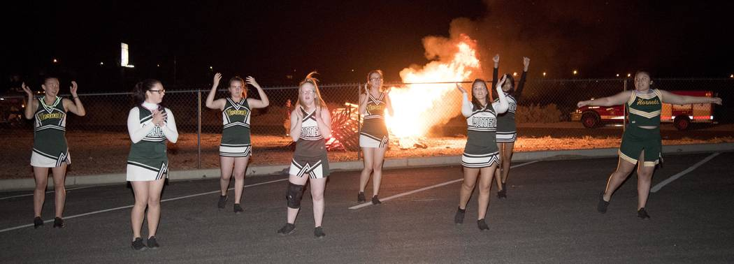 Richard Stephens/ Pahrump Valley Times Freshman, more wood! Beatty High School celebrates homecoming with a pep ralley at the old bonfire while the Hornets cheer squad cheers.