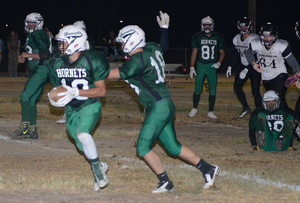 Richard Stephens/ Pahrump Valley Times Sophomore Fabian Perez on one of two touchdown runs at the Beatty homecoming game against Round Mountain last Friday.