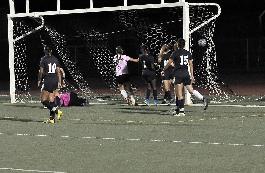 Horace Langford Jr./Pahrump Valley Times  Junior forward Grace Gundacker uses her speed to get this last goal against Cheyenne for the Trojans, which put the game on ice. Pahrump plays its last ga ...